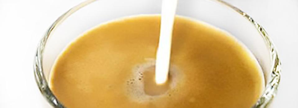 Milk pouring to make a Cortado